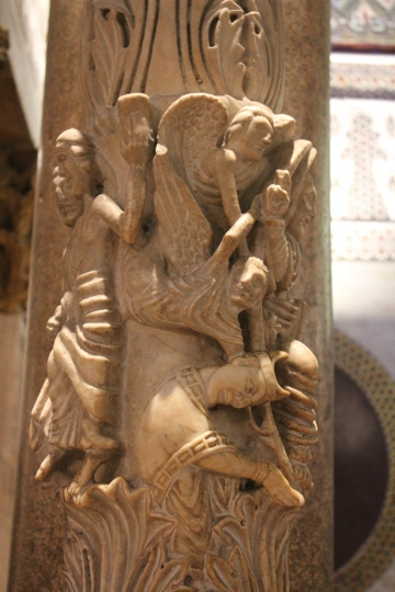 Carved figures on the paschal candelabra in the Palantine Chapel in Palermo