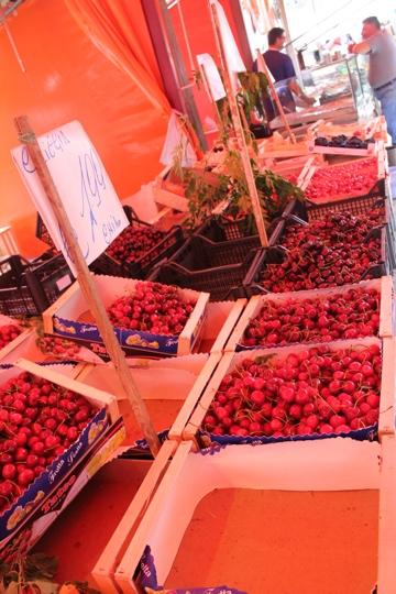 Cherries under the red glow of the Ballaro Market, Palermo