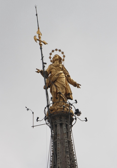 Madonnina statue on the top of the Duomo in Milan