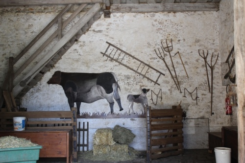 Decoration on the wall of a farm building, Queen's Hamlet, Versailles