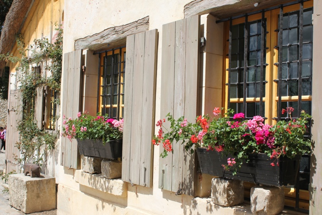 Flower boxes on the farm buildings at the Queen's Hamlet, Versailles