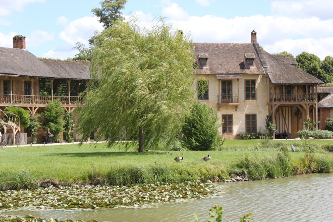 The Queen's House overlooking the lake at the Hamlet at Versailles